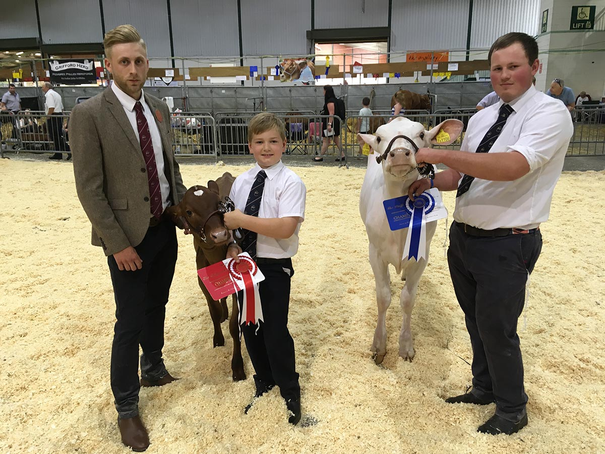 Judge Ben Whittaker with Champion Handler David Oultram and Reserve Dave Madeley